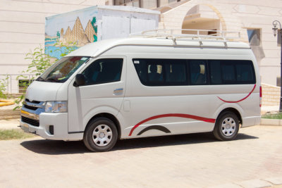White commercial passenger mini bus waiting for tourists